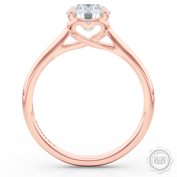 "Award-Winning Solitaire Engagement Ring Design. Classic Round Solitaire Handcrafted in Romantic Rose Gold. Signature ""Infinity Heart"" Crown Accentuated by Gently Tapered Shoulders. GIA Certified Diamond. Free Shipping USA. 30-Day Returns 