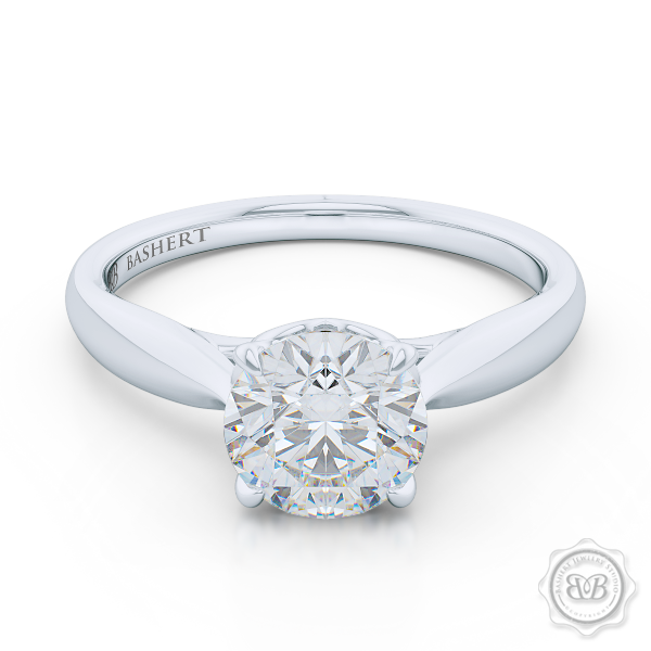 "Award-Winning Engagement Ring Design. Classic Round Solitaire Handcrafted in White Gold or Precious Platinum. Signature ""Infinity Heart"" Crown Accentuated by Gently Tapered Shoulders. Find a GIA Certified Diamond Tailored to Your Budget. Choice of  Plain or Diamond Matching Wedding Band For Her. Free Shipping USA. 30Day Returns 