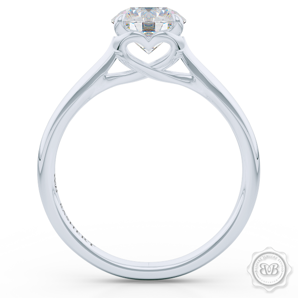 "Award-Winning Solitaire Engagement Ring Design. Classic Round Solitaire Handcrafted in White Gold or Precious Platinum. Signature ""Infinity Heart"" Crown Accentuated by Gently Tapered Shoulders. Forever One Round Brilliant Moissanite.  Free Shipping USA. 30-Day Returns 