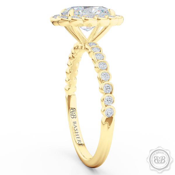 Luscious Oval Cut Diamond Halo Engagement Ring, Crafted in Classic Yellow Gold. Stunning Halo Crown of Bezel-Set Diamonds Encrusted in Elegant Ocean Swirls. Free Shipping USA. 30Day Returns | BASHERT JEWELRY | Boca Raton Florida
