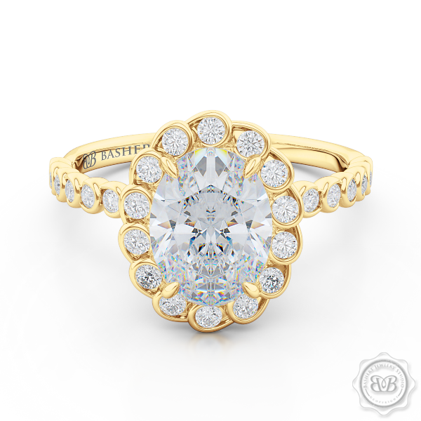 Luscious Oval Cut FOREVER ONE Moissanite Halo Engagement Ring, Crafted in Classic Yellow Gold. Stunning Halo Crown of Bezel-Set Diamonds Encrusted in Elegant Ocean Swirls. Free Shipping USA. 30-Day Returns | BASHERT JEWELRY | Boca Raton, Florida