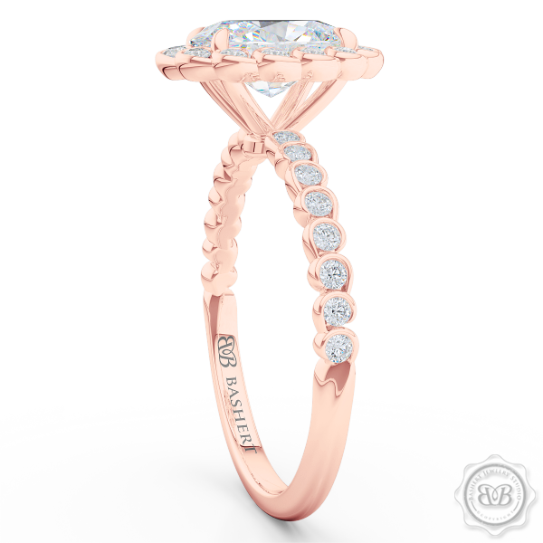 Luscious Oval Cut Diamond Halo Engagement Ring, Crafted in Romantic Rose Gold. Stunning Halo Crown of Bezel-Set Diamonds Encrusted in Elegant Ocean Swirls. Free Shipping USA. 30Day Returns | BASHERT JEWELRY | Boca Raton Florida