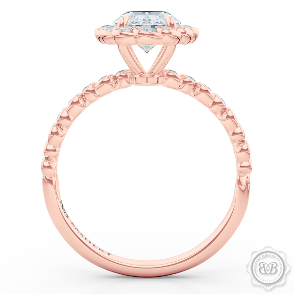 Luscious Oval Cut FOREVER ONE Moissanite Halo Engagement Ring, Crafted in Romantic Rose Gold. Stunning Halo Crown of Bezel-Set Diamonds Encrusted in Elegant Ocean Swirls. Free Shipping USA. 30-Day Returns | BASHERT JEWELRY | Boca Raton, Florida