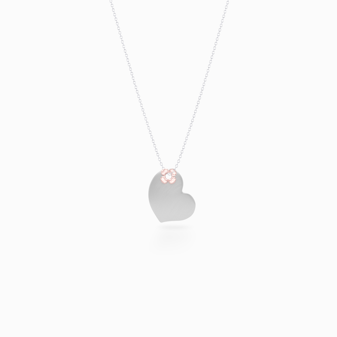 Delicate, two-tone Heart Pendant Necklace. Hand-fabricated in Sterling Silver and solid rose gold, lucky-clover-flower accent. Free Shipping to all USA. 15 Day Returns.  BASHERT JEWELRY | Boca Raton, Florida