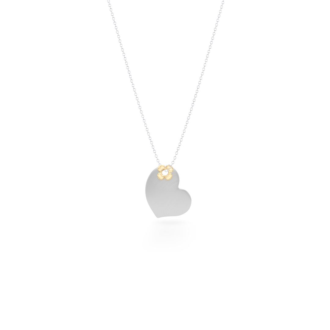 Delicate, two-tone Heart Pendant Necklace. Hand-fabricated in Sterling Silver and solid Yellow Gold, lucky-clover-flower accent. Free Shipping to all USA. 15 Day Returns.  BASHERT JEWELRY | Boca Raton, Florida