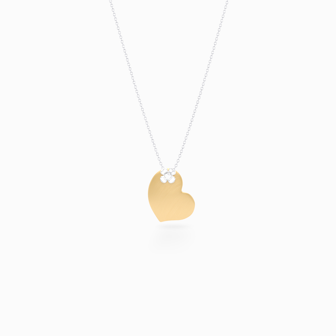 Two-tone gold Heart Pendant Necklace. Hand-fabricated in Yellow and White solid Gold. Lucky-clover-flower accent. Free Shipping to all USA. 15 Day Returns.  BASHERT JEWELRY | Boca Raton, Florida