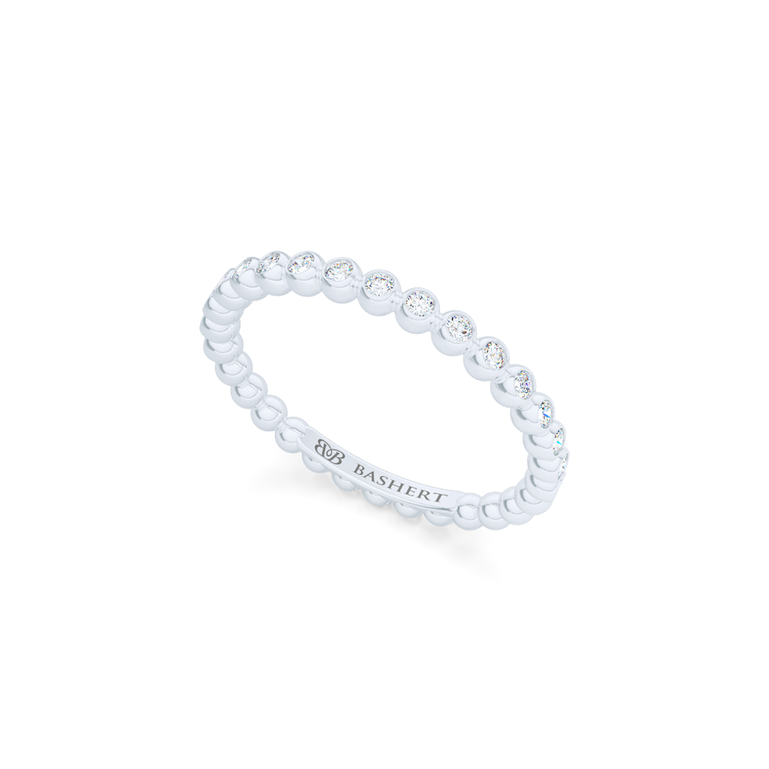 Delicate, bezel-set pots diamond eternity wedding band. Hand-fabricated in solid, sustainable Precious Platinum and premium quality Round, Brilliant Diamonds. Free Shipping for All USA Orders. 15-Day Returns | BASHERT JEWELRY | Boca Raton, Florida