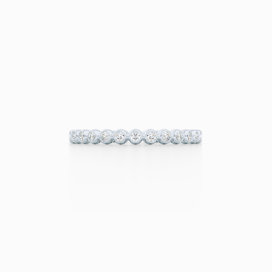 Delicate, bezel-set pots diamond eternity wedding band. Hand-fabricated in solid, sustainable White Gold and premium quality Round, Brilliant Diamonds. Free Shipping for All USA Orders. 15-Day Returns | BASHERT JEWELRY | Boca Raton, Florida