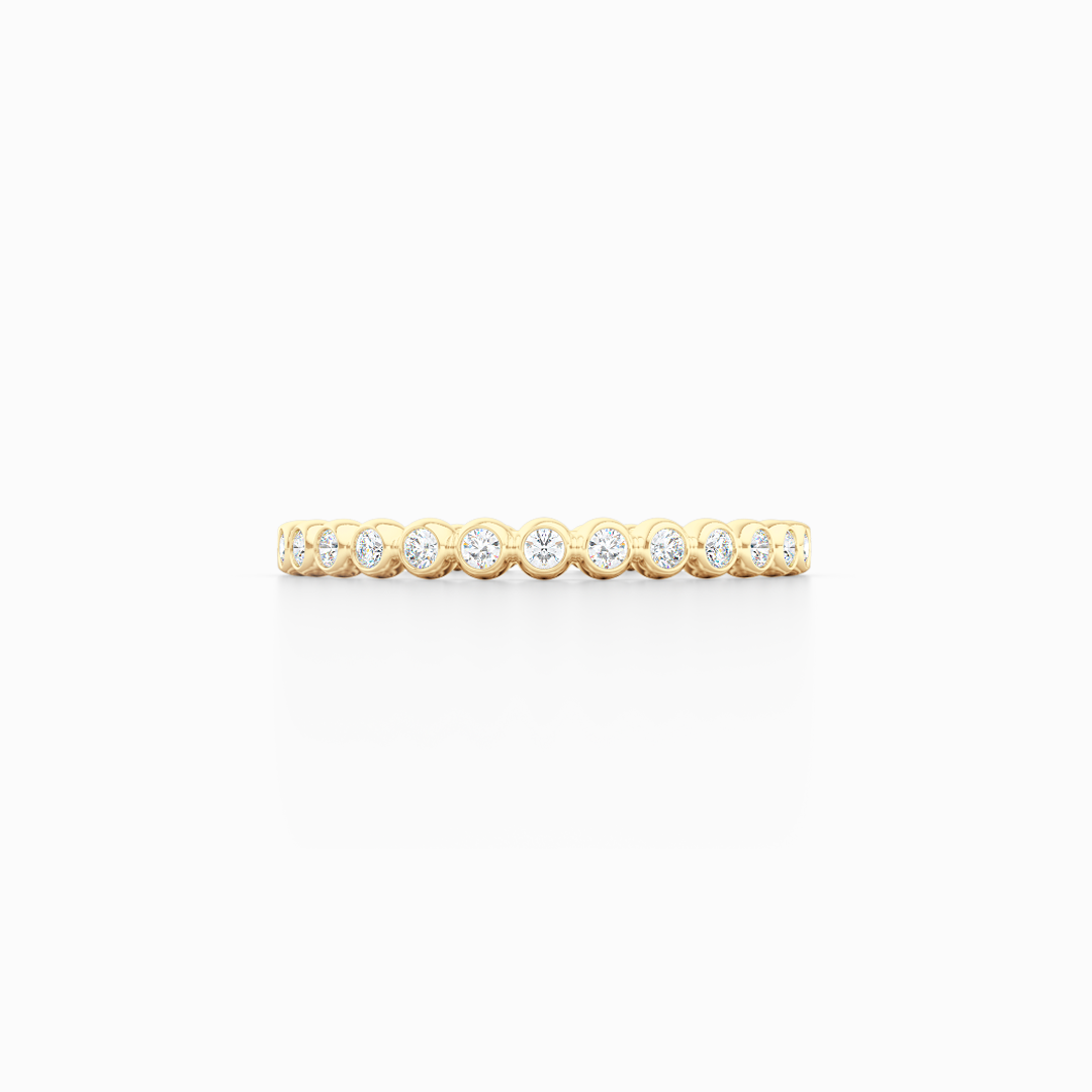 Delicate, bezel-set pots diamond eternity wedding band. Hand-fabricated in solid, sustainable Yellow Gold and premium quality Round, Brilliant Diamonds. Free Shipping for All USA Orders. 15-Day Returns | BASHERT JEWELRY | Boca Raton, Florida