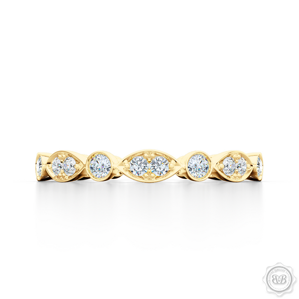 A delicate, eternity diamond wedding ring, handcrafted in Classic Yellow Gold. A brilliant array of premium quality round brilliant diamonds, set in round and marquise bezel pods. Free Shipping for All USA Orders. 30-Day Returns | BASHERT JEWELRY | Boca Raton, Florida