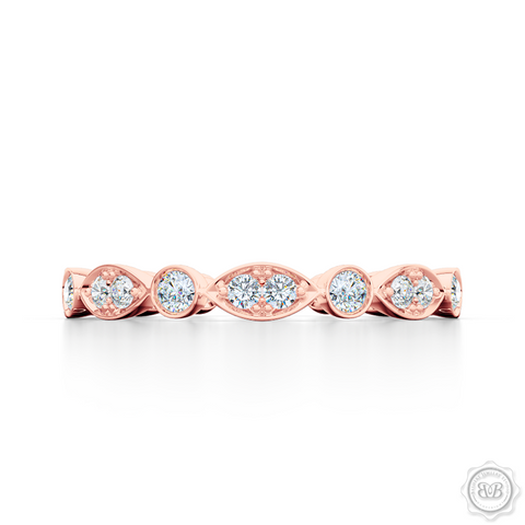 A delicate, eternity diamond wedding ring, handcrafted in Romantic Rose Gold. A brilliant array of premium quality round brilliant diamonds, set in round and marquise bezel pods. Free Shipping for All USA Orders. 30-Day Returns | BASHERT JEWELRY | Boca Raton, Florida