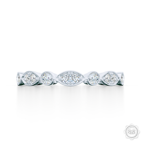 A delicate, eternity diamond wedding ring, handcrafted in White Gold or Platinum. A brilliant array of premium quality round brilliant diamonds, set in round and marquise bezel pods. Free Shipping for All USA Orders. 30-Day Returns | BASHERT JEWELRY | Boca Raton, Florida