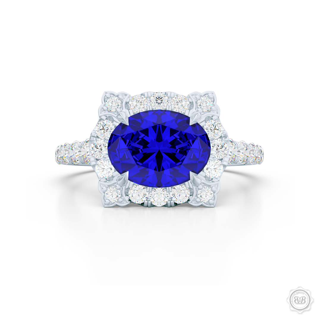 East-West Oval Blue Sapphire Halo Engagement Ring. Handcrafted in Precious Platinum or White Gold. Royal Blue Oval Sapphire. Vintage-inspired lines with a unique flower prong accents, adorned with Round Brilliant Diamonds. Free Shipping USA. 30-Day Returns | BASHERT JEWELRY | Boca Raton, Florida