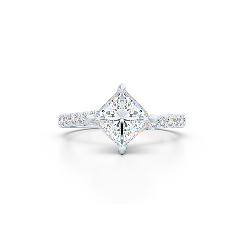 East-West, four prong, Princess Solitaire. Recessed diamond halo. Diamond adorned shoulders. Hand-fabricated in Sustainable Solid White Gold. Available in Moissanite by Charles & Colvard or Lab-Grown Diamond by Diamond Foundry. | Made in Boca Raton, Florida. 15 Day Returns. Free Shipping USA. | Bashert Jewelry