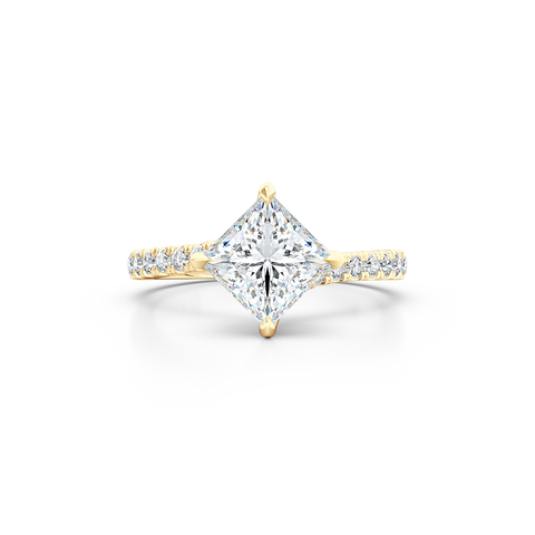 A unique, east-west princess cut Solitaire. Recessed diamond halo. Diamond-adorned shoulders. Hand-fabricated in Classic Yellow Gold. Available in GIA certified Diamond or Lab-Grown Diamond by Diamond Foundry. | Made in Boca Raton, Florida. 15 Day Returns. Free Shipping USA. | Bashert Jewelry