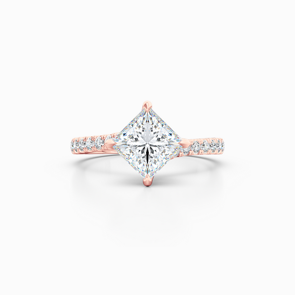 A unique, east-west princess cut Solitaire. Recessed diamond halo. Diamond-adorned shoulders. Hand-fabricated in Romantic Rose Gold. Available in GIA certified Diamond or Lab-Grown Diamond by Diamond Foundry. | Made in Boca Raton, Florida. 15 Day Returns. Free Shipping USA. | Bashert Jewelry