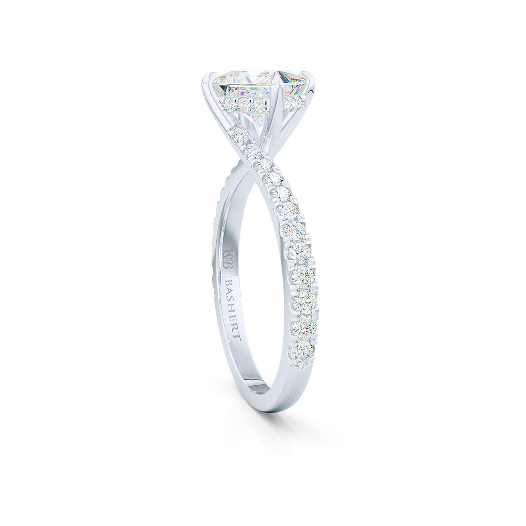 A unique, east-west princess cut Solitaire. Recessed diamond halo. Diamond-adorned shoulders. Hand-fabricated in White Gold or Precious Platinum. Available in GIA certified Diamond or Lab-Grown Diamond by Diamond Foundry. | Made in Boca Raton, Florida. 15 Day Returns. Free Shipping USA. | Bashert Jewelry
