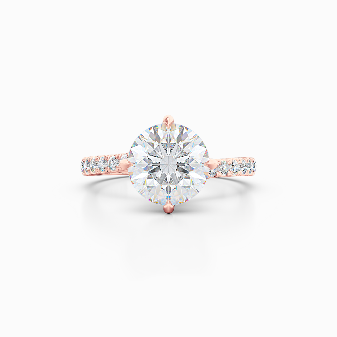 East-West, four prong, Round Solitaire. Recessed diamond halo. Diamond adorned shoulders. Hand-fabricated in Romantic Rose Gold. Available in Diamond or Lab-Grown Diamond. | Made in Boca Raton, Florida. 15 Day Returns. Free Shipping USA. | Bashert Jewelry