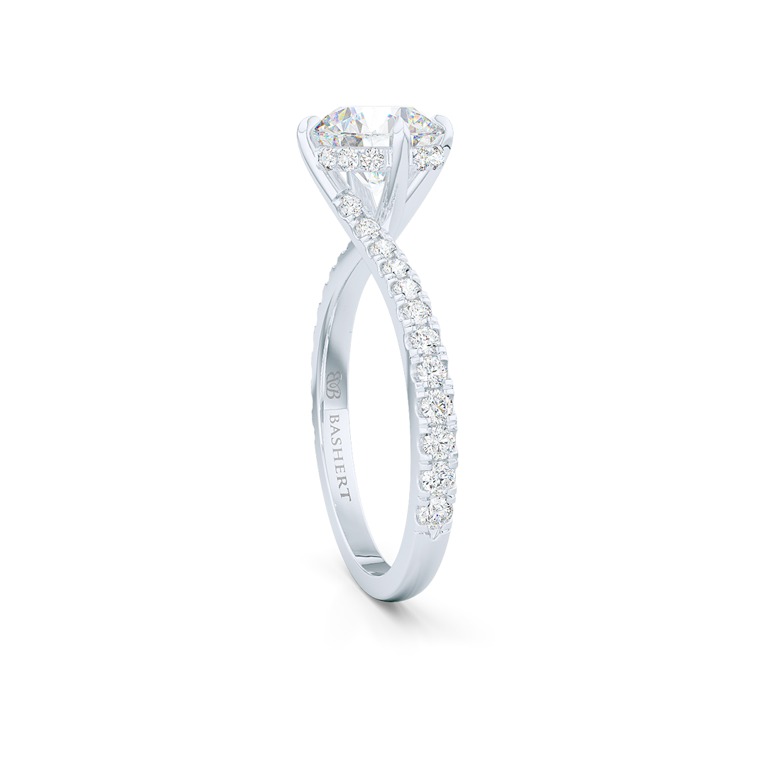 East-West, four prong, Round Solitaire. Recessed diamond halo. Diamond adorned shoulders. Hand-fabricated in Precious Platinum. Available in Diamond or Lab-Grown Diamond. | Made in Boca Raton, Florida. 15 Day Returns. Free Shipping USA. | Bashert Jewelry