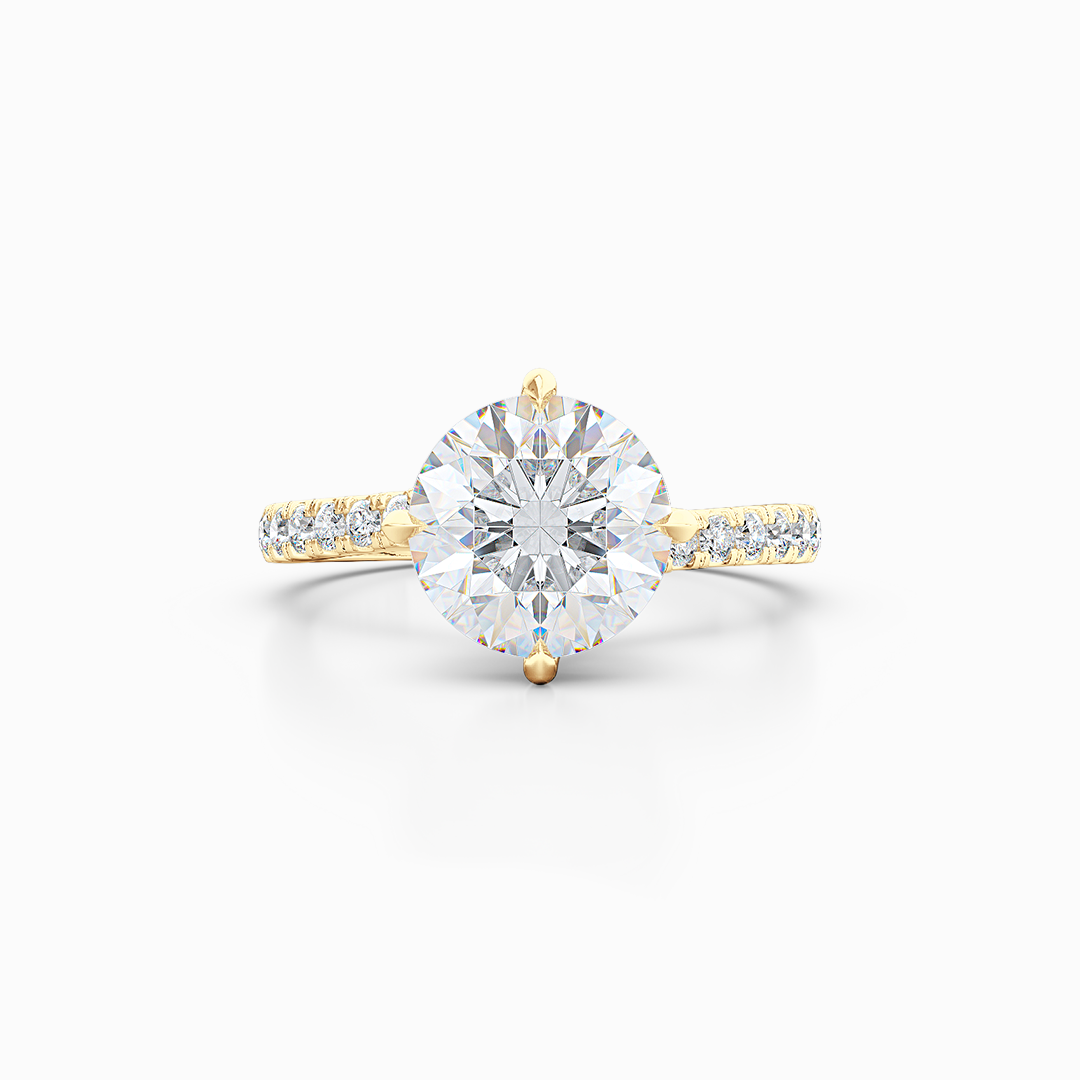 East-West, four prong, Round Solitaire. Recessed diamond halo. Diamond adorned shoulders. Hand-fabricated in Sustainable Solid Yellow Gold. Available in Moissanite by Charles & Colvard or Lab-Grown Diamond by Diamond Foundry. | Made in Boca Raton, Florida. 15 Day Returns. Free Shipping USA. | Bashert Jewelry