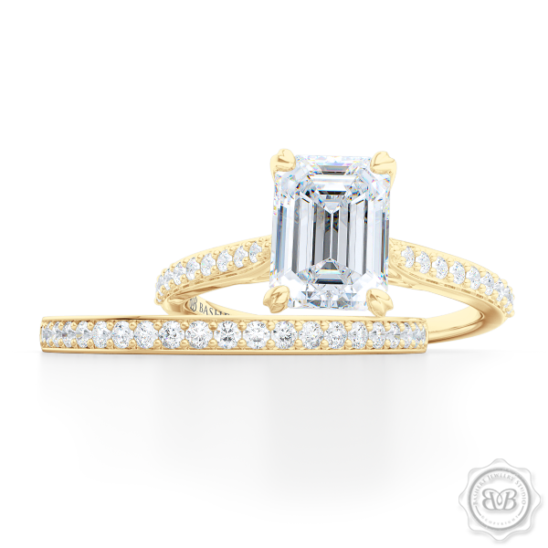 Classic Four-Prong GIA Certified Emerald Cut Diamond Solitaire Ring Handcrafted in Classic Yellow Gold and Platinum. Elegantly Tapered Bead-Set Diamond Shoulders. Find a GIA Certified Diamond Tailored to Your Budget. This Design Offers a Matching Bead-Set Diamond Wedding Band For Her. Free Shipping USA. 30Day Returns | BASHERT JEWELRY | Boca Raton Florida