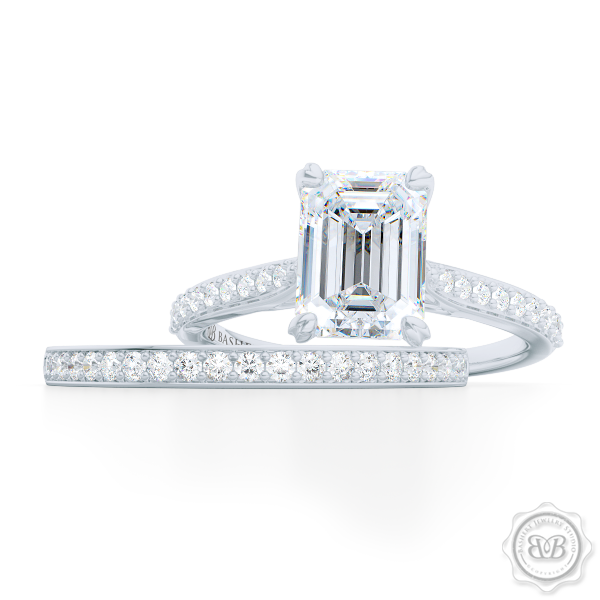 Classic Four-Prong GIA Certified Emerald Cut Diamond Solitaire Ring Handcrafted in White Gold or Platinum. Elegantly Tapered Bead-Set Diamond Shoulders. Find a GIA Certified Diamond Tailored to Your Budget. This Design Offers a Matching Bead-Set Diamond Wedding Band For Her. Free Shipping USA. 30Day Returns | BASHERT JEWELRY | Boca Raton Florida