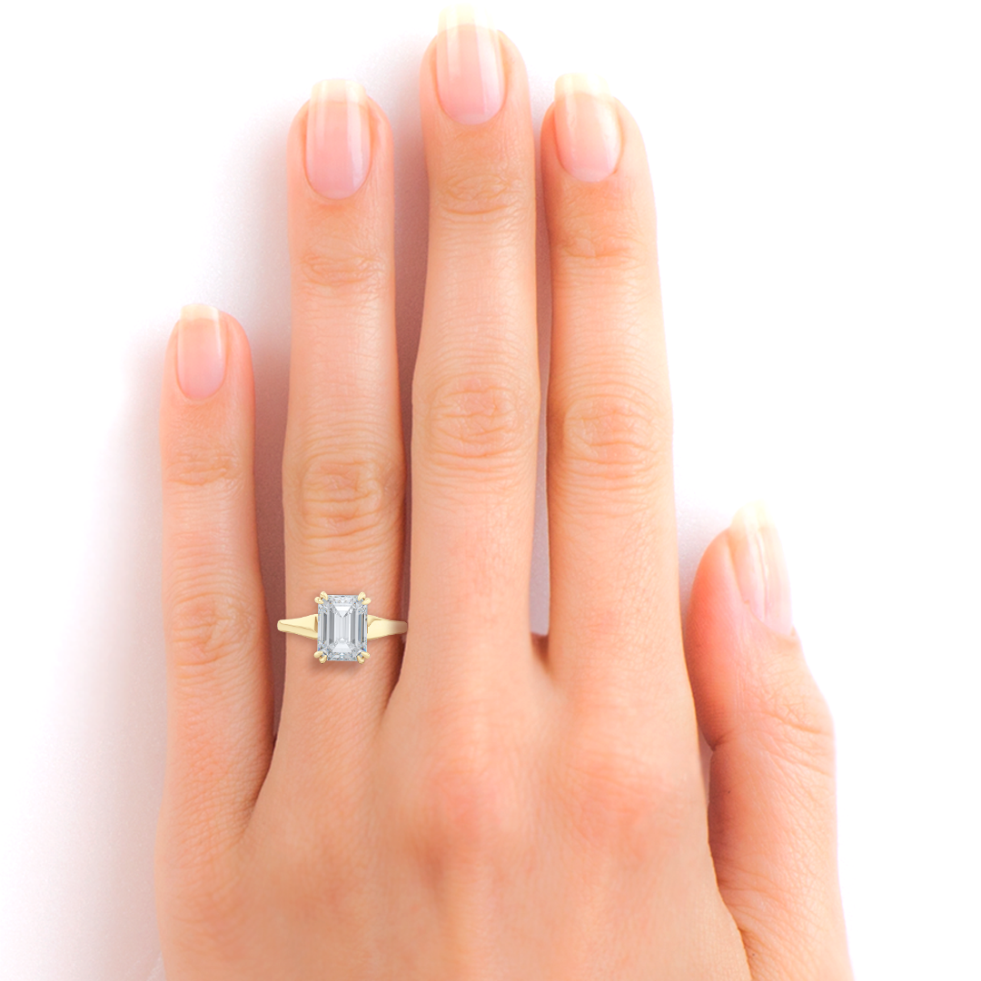 Classic, Emerald Cut Moissanite Solitaire Ring. Hand-fabricated in sustainable, solid Yellow Gold and Forever One Charles & Colvard Moissanite.  Free Shipping to all US orders. 15 Day Returns | BASHERT JEWELRY | Boca Raton, Florida