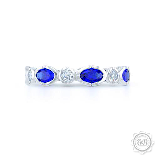 Sapphire and Diamond Eternity band. Handcrafted in White Gold or Precious Platinum. Adorned with array of Round Diamond and Oval Blue Sapphires. Geometrical Wedding, Eternity, Stackable Band that can be customized with gemstones of your choice. Free Shipping on All USA Orders. 30-Day Returns | BASHERT JEWELRY | Boca Raton, Florida