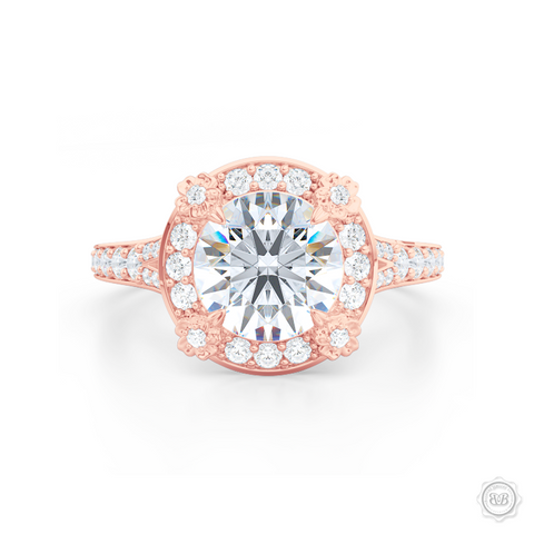 Flower inspired Round Diamond Halo Engagement ring with a vintage appeal, set in Romantic Rose Gold. Signature floret prongs, dazzling baby-split ring shoulders. Gia certified Round Brilliant Diamond. Free Shipping USA. 30-Day Returns | BASHERT JEWELRY | Boca Raton, Florida.