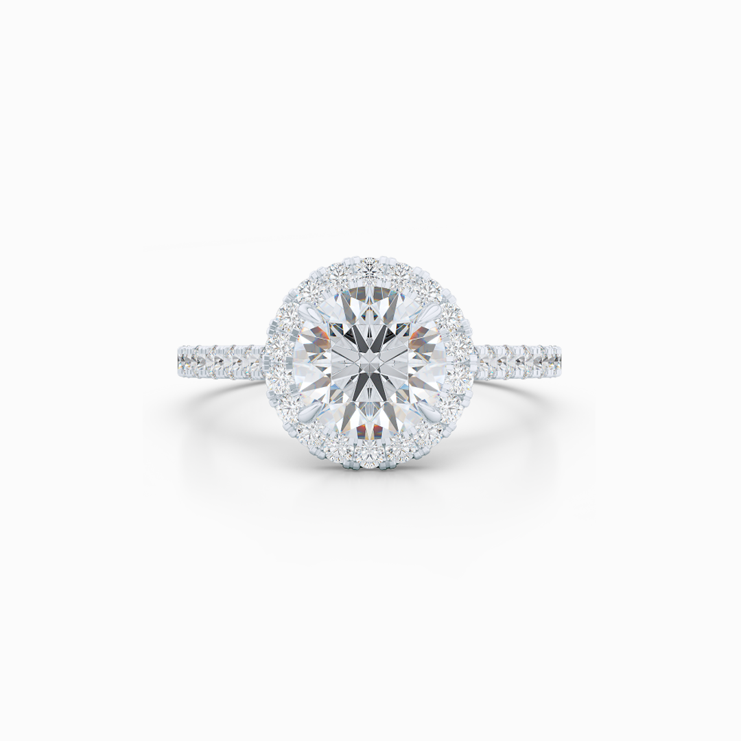 Classic micro-pavé round Halo Engagement Ring. Hand-fabricated in solid, sustainable Precious Platinum. Forever One certified Round Brilliant Moissanite by Charles and Colvard. Free Shipping USA. 15 Day Returns | BASHERT JEWELRY | Boca Raton, Florida