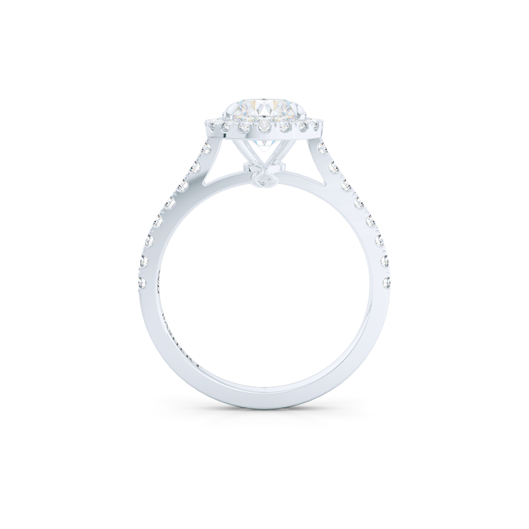 Classic Round Halo Engagement Ring, hand-fabricated in White Gold and Round Brilliant, Forever-One Moissanite by Charles and Colvard. Dazzling diamond micro pavè set shoulders. Free Shipping USA. 15 Day Returns | BASHERT JEWELRY | Boca Raton, Florida.
