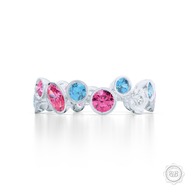 Unique Floral Motif Eternity Ring, Handcrafted in White Gold, Sky Blue Topaz, and Pink Tourmalines. Customize it with Birthstones or Anniversary gems of Your Choice. Free Shipping USA. 30 Day Returns. BASHERT JEWELRY | Boca Raton, Florida