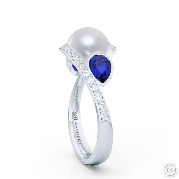 Unique Infinity Pearl Engagement Ring handcrafted in White Gold or Precious Platinum. Award-winning design featuring dazzling 10.00mm Cultured Akoya Pearl, accentuated by matching Pear Shaped Royal Blue Sapphires. The infinity intertwined shoulders of the ring are adorned with Round Brilliant diamonds, set in classic bead-set. BASHERT JEWELRY | Boca Raton, Florida