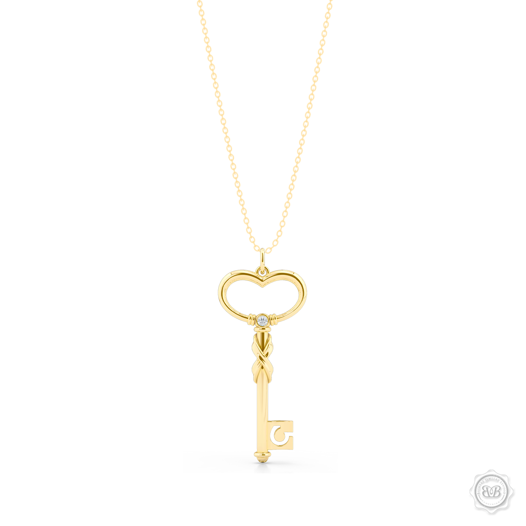 Heart Key Pendant Necklace with an Infinity Twist element. Handcrafted in Classic Yellow Gold. We can further style this design with a birthstone of choice. Free Shipping USA. 30-Day Returns. Free Silver Chain | BASHERT JEWELRY | Boca Raton, Florida