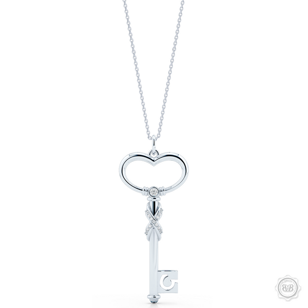 Heart Key Pendant Necklace with a Diamond Adorned Infinity Twist. Handcrafted in Sterling Silver or White Gold. Style this design with a gem of your choice to create a unique look that's exactly you. Available in two sizes. Free Shipping USA. 30Day Returns. Free Silver Chain | BASHERT JEWELRY | Boca Raton Florida