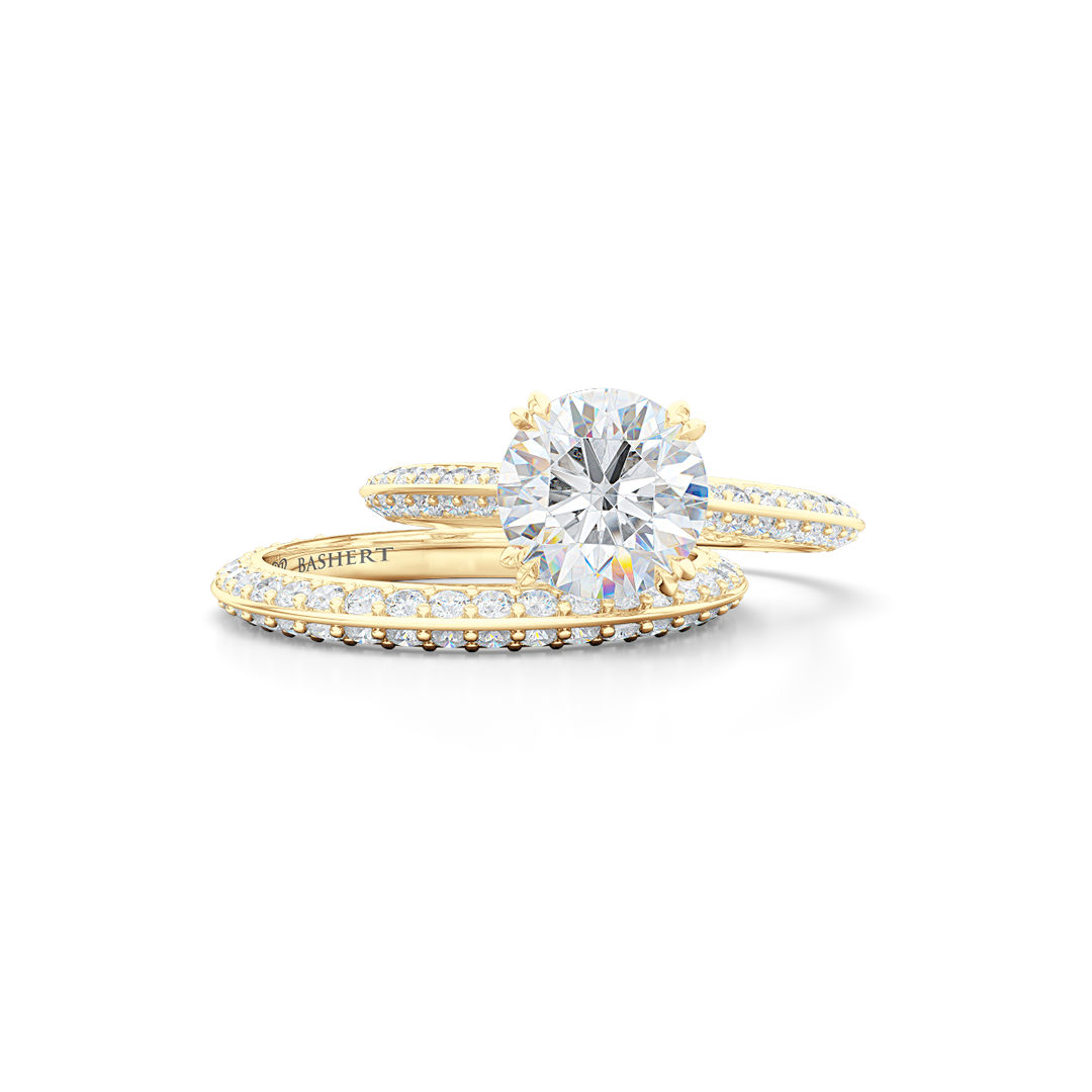 A classic Knife-edge Solitaire Engagement Ring with a recessed hidden diamond halo. Hand fabricated in Classic Yellow Gold. 100%  recycled, sustainable, precious metals.  Round Brilliant Forever One Moissanite by Charles & Colvard.  Free Shipping on All USA Orders. 15 Days Returns | BASHERT JEWELRY | Boca Raton, Florida