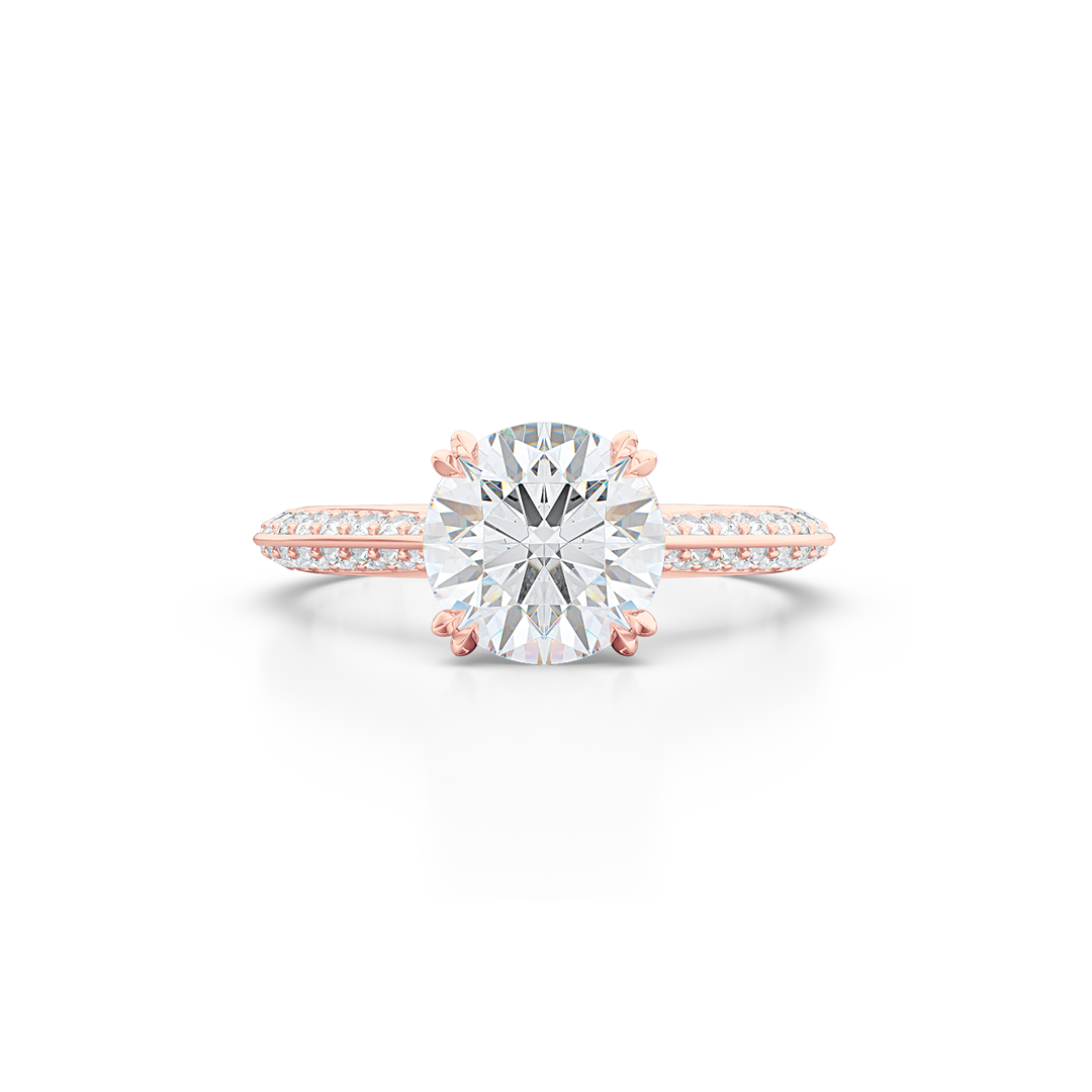 A classic Knife-edge Solitaire Engagement Ring with a recessed hidden diamond halo. Hand fabricated in Romantic Rose Gold. 100%  recycled, sustainable, precious metals.  Round Brilliant Forever One Moissanite by Charles & Colvard.  Free Shipping on All USA Orders. 15 Days Returns | BASHERT JEWELRY | Boca Raton, Florida
