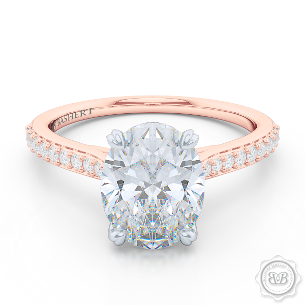 Classic Oval Cut Diamond Solitaire Ring Handcrafted in Romantic Rose Gold and Platinum. Elegant Bead-Set Diamond Shoulders. Find a GIA Certified Diamond Tailored to Your Budget. Create Your Own Dream Engagement Ring. This Design Offers a Matching Wedding Band For Her. Free Shipping USA. 30Day Returns | BASHERT JEWELRY | Boca Raton Florida