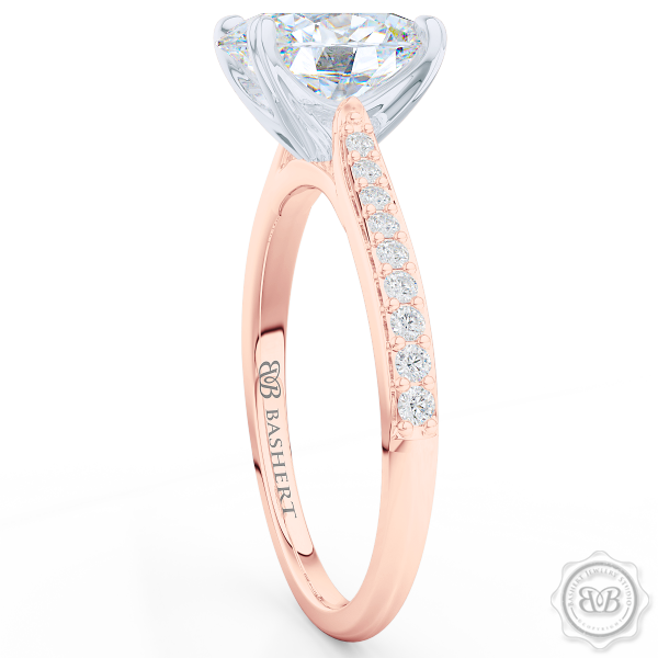 Classic Oval Solitaire Engagement Ring. Handcrafted in two-tone Rose Gold and Platinum. Elegant Bead-Set Diamond Shoulders. Forever One Moissanite by Charles & Colvard.  Free Shipping USA. 30-Day Returns | BASHERT JEWELRY | Boca Raton, Florida.
