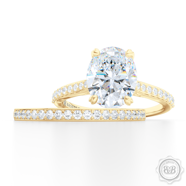 Classic Oval Solitaire Engagement Ring. Handcrafted in two-tone Yellow Gold and Platinum. Elegant Bead-Set Diamond Shoulders. Forever One Moissanite by Charles & Colvard.  Free Shipping USA. 30-Day Returns | BASHERT JEWELRY | Boca Raton, Florida.