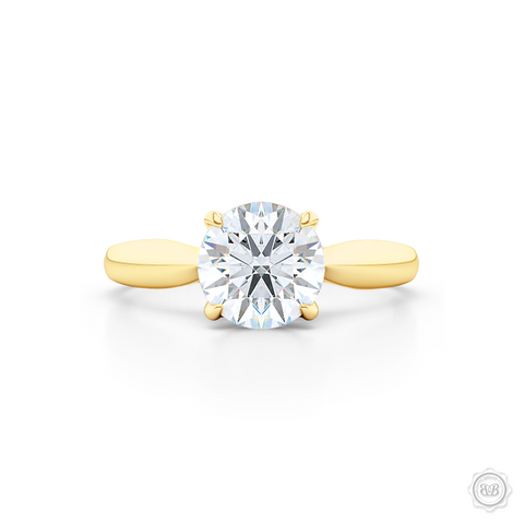 "Award-Winning Solitaire Engagement Ring Design. Classic Round Solitaire Handcrafted in Classic Yellow Gold. Signature ""Infinity Heart"" Crown Accentuated by Gently Tapered Shoulders. Forever One Round Brilliant Moissanite.  Free Shipping USA. 30-Day Returns 