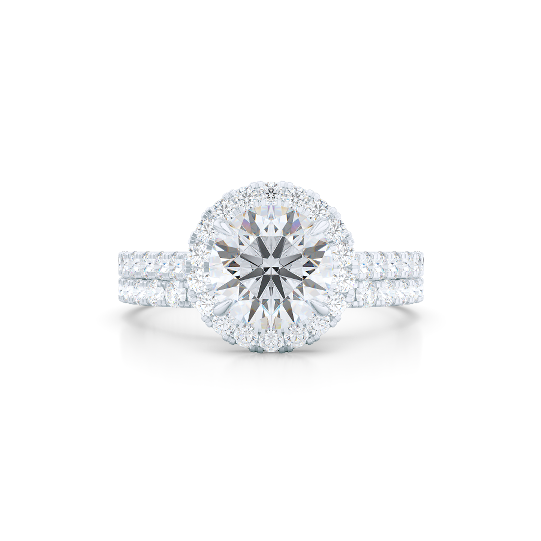 Classic micro-pavé round Halo Engagement Ring. Hand-fabricated in solid, sustainable White Gold. GIA certified Round Brilliant Diamond. Free Shipping USA. 15 Day Returns | BASHERT JEWELRY | Boca Raton, Florida