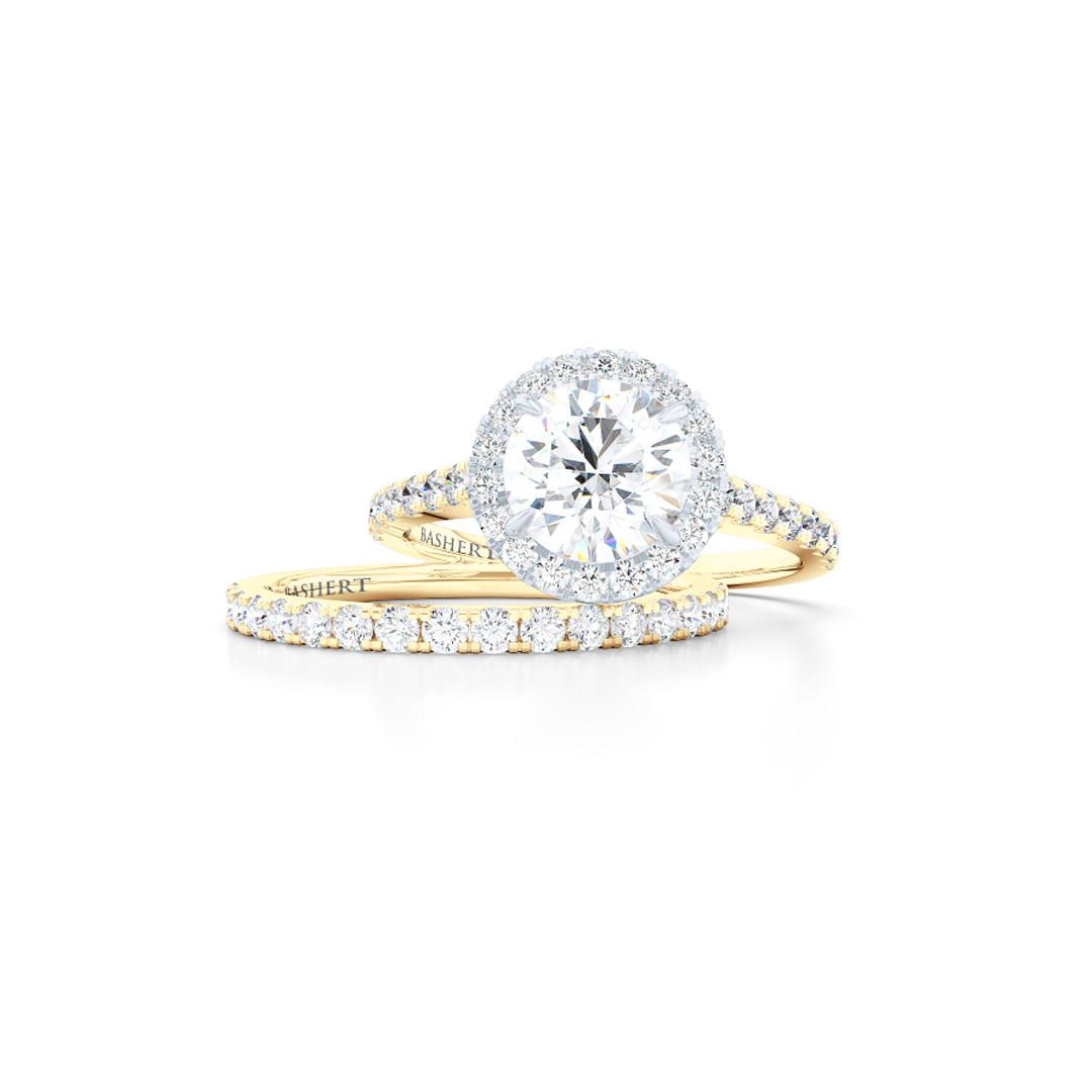 Classic micro-pavé round Halo Engagement Ring. Hand-fabricated in solid, sustainable Yellow Gold and Precious Platinum crown. GIA certified Round Brilliant Diamond. Free Shipping USA. 15 Day Returns | BASHERT JEWELRY | Boca Raton, Florida