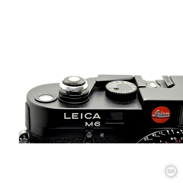 Bashert Jewelry custom handcrafted soft release buttons for Leica cameras. Polished and Oxidized Sterling Silver 925 and Genuine Onyx. Proudly Made in America. Free Shipping to USA.