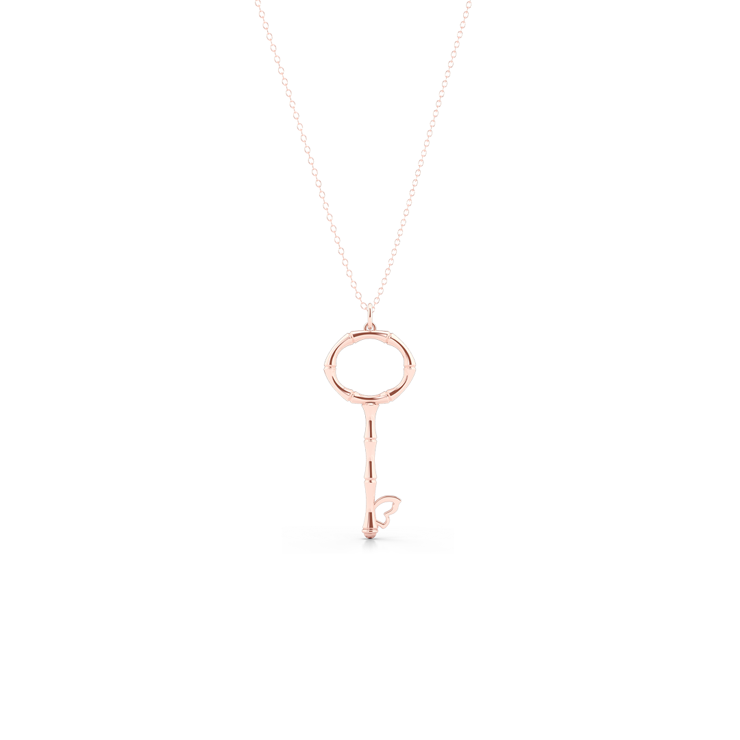 Bamboo inspired, Rose Gold Key Pendant. Delicate Butterfly accent. Hand-fabricated in sustainable, solid, 14K Rose Gold. Key pendants are a classic jewelry statement for girls of all ages. Free Shipping for All US Orders. 15 Day Returns | BASHERT JEWELRY | Boca Raton Florida