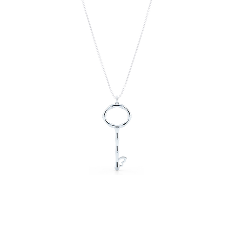 Bamboo inspired, White Gold Key Pendant. Delicate Butterfly accent. Hand-fabricated in sustainable, solid, 18K White Gold. Key pendants are a classic jewelry statement for girls of all ages. Free Shipping for All US Orders. 15 Day Returns | BASHERT JEWELRY | Boca Raton Florida