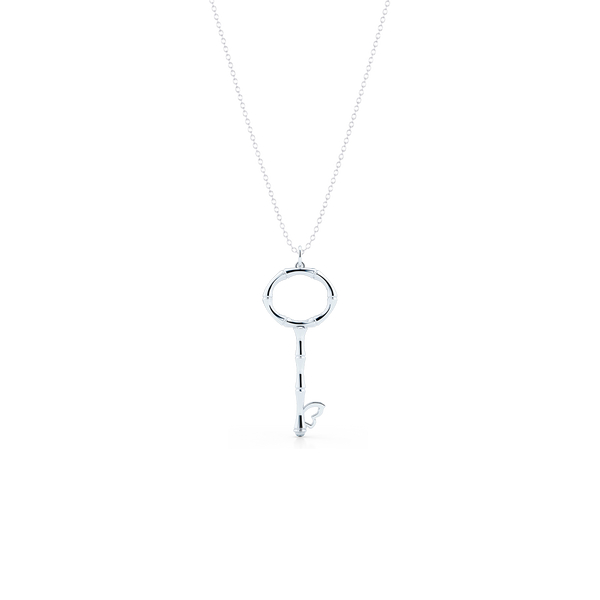 Bamboo inspired, White Gold Key Pendant. Delicate Butterfly accent. Hand-fabricated in sustainable, solid, 14K White Gold. Key pendants are a classic jewelry statement for girls of all ages. Free Shipping for All US Orders. 15 Day Returns | BASHERT JEWELRY | Boca Raton Florida