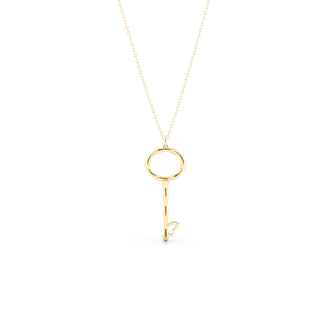 Bamboo inspired, Yellow Gold Key Pendant. Delicate Butterfly accent. Hand-fabricated in sustainable, solid, 18K Gold. Key pendants are a classic jewelry statement for girls of all ages. Free Shipping for All US Orders. 15 Day Returns | BASHERT JEWELRY | Boca Raton Florida