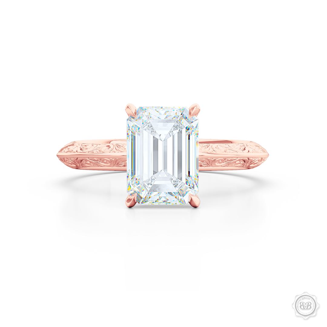 Solitaire Engagement Ring. Emerald Step-Cut GIA Certified Excellent Graded Diamond. Handcrafted in Romantic Rose Gold. The uniquely structured, soft bevel, shoulders of the ring are ornate with hand-carved baroque swirls. Free Shipping for All USA Orders. 30-Day Returns | BASHERT JEWELRY | Boca Raton, Florida