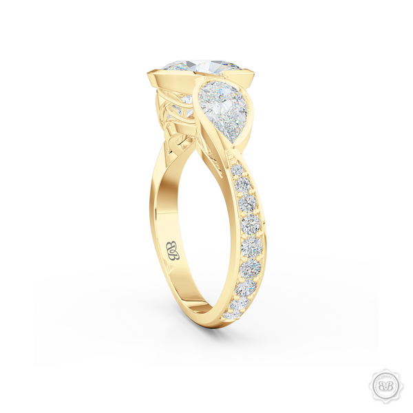 Three stone Diamond engagement ring. Oval Cut GIA certified Diamond. Pear shape side stones. Handcrafted in Classic Yellow Gold. Free Shipping on All USA Orders. 30-Day Returns | BASHERT JEWELRY | Boca Raton, Florida